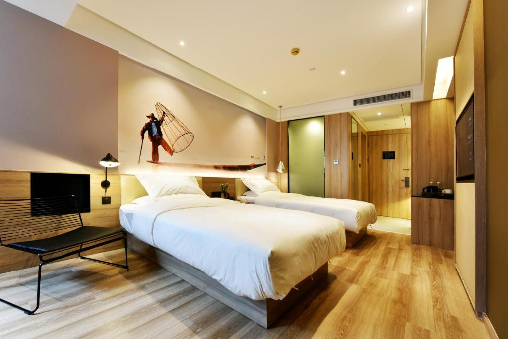 Ein Bett oder Betten in einem Zimmer der Unterkunft Urban Rosa Cafe&Inn