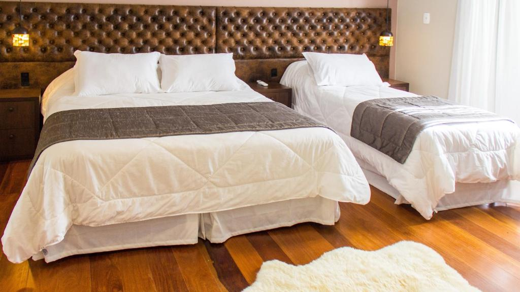 A bed or beds in a room at Tri Pousada Caracol