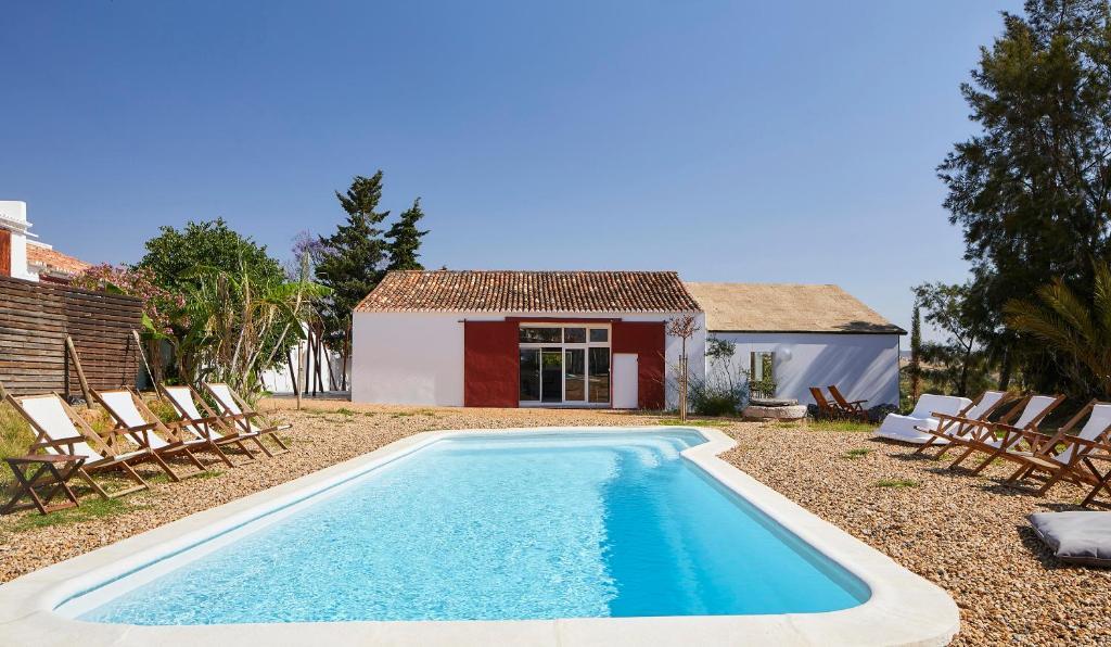 The swimming pool at or near Companhia das Culturas - Ecodesign & Spa Hotel