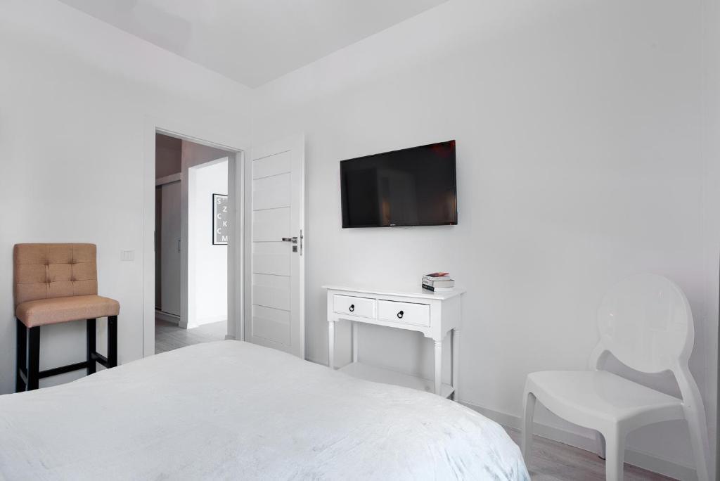 En eller flere senger på et rom på Apartament 222 Apartamenty No.1