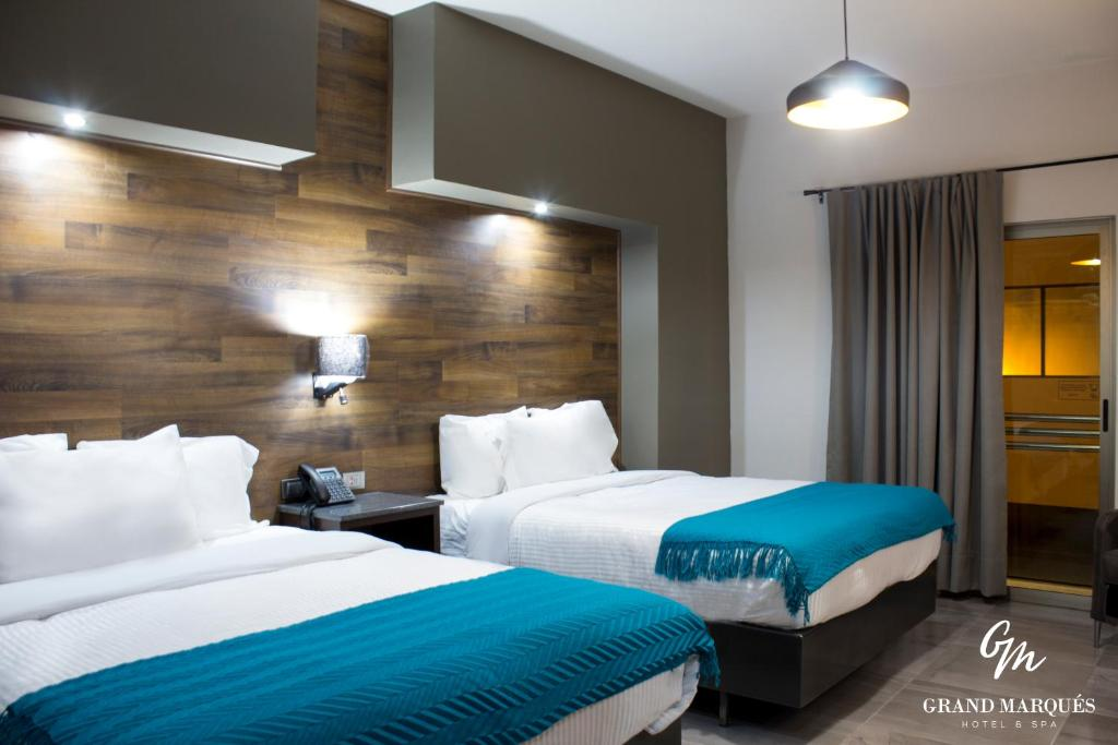 A bed or beds in a room at Grand Marques