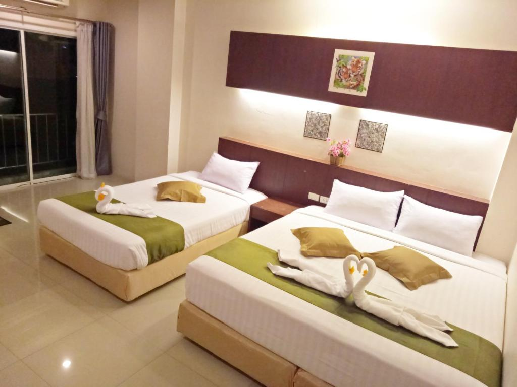 A bed or beds in a room at 7 Sky Residency