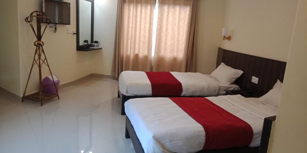 מיטה או מיטות בחדר ב-Hotel Fewa Dream