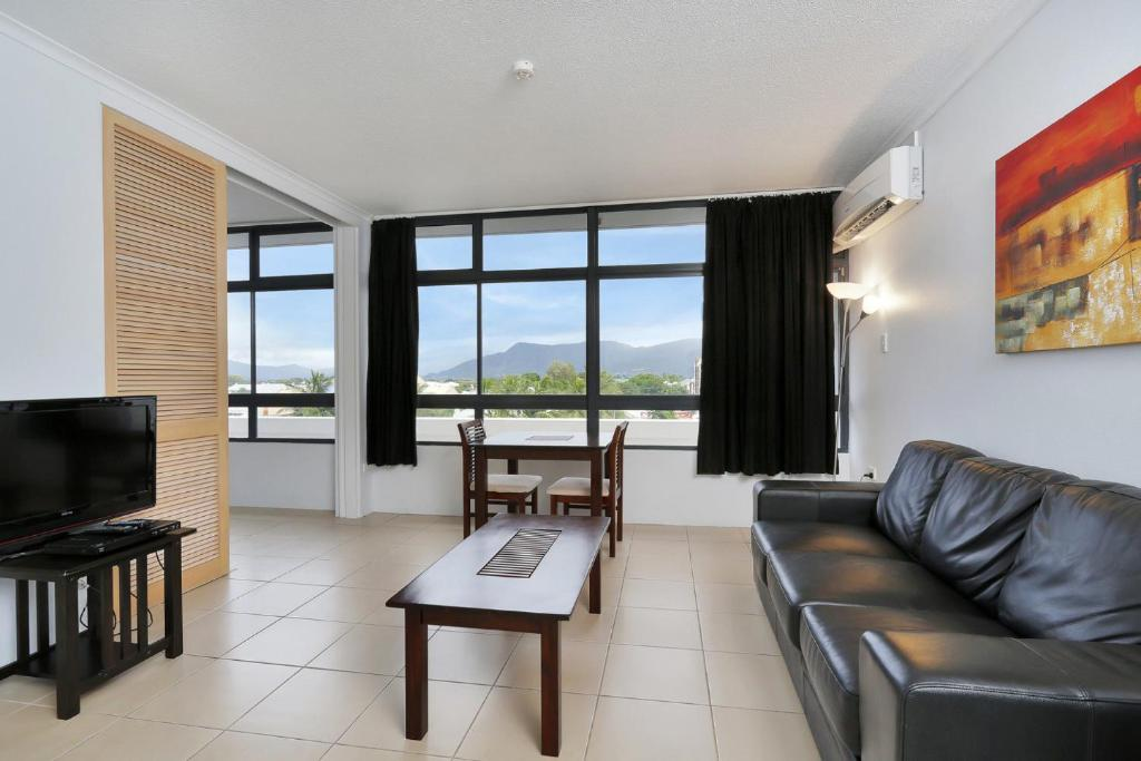 A seating area at Sunshine Towers 407 - One Bedroom Studio Apartment