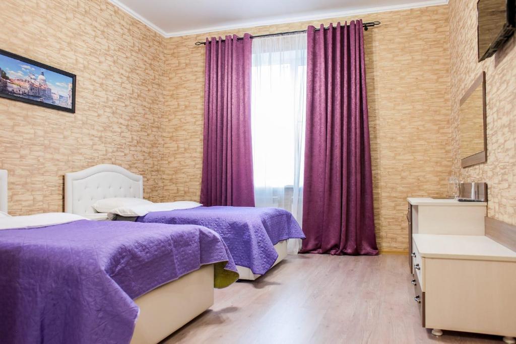 Кровать или кровати в номере Гостиница Джулия
