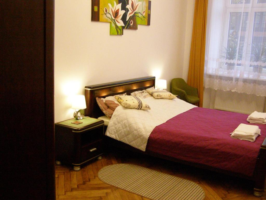 A bed or beds in a room at Kazimierz