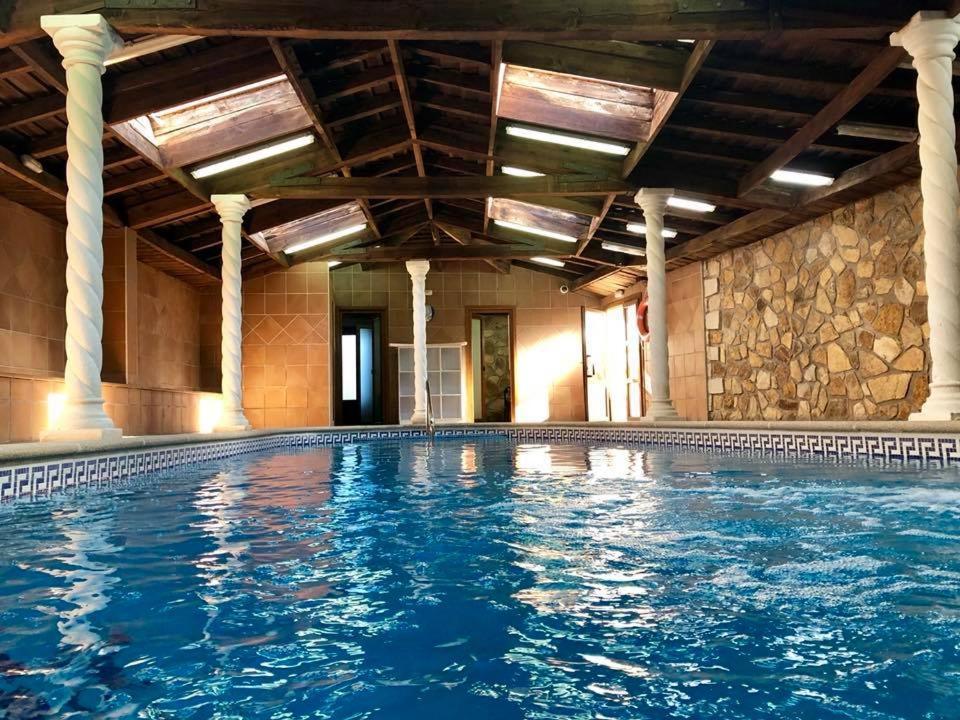The swimming pool at or near El Encanto del Valle del Lozoya