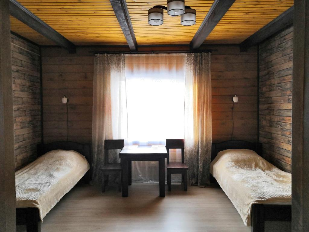A bed or beds in a room at Хостел Улей