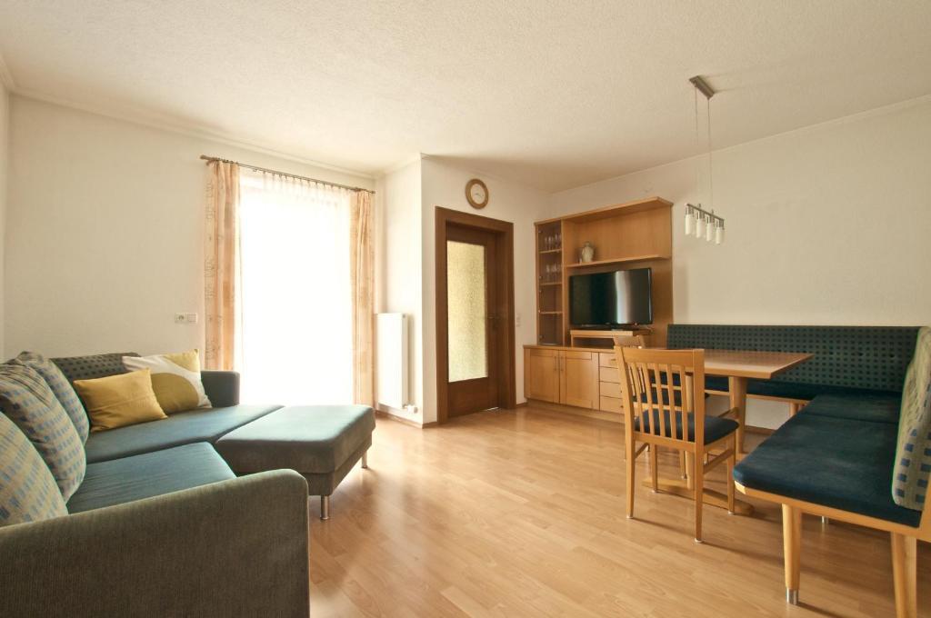 Ein Sitzbereich in der Unterkunft Edelberg Apartments