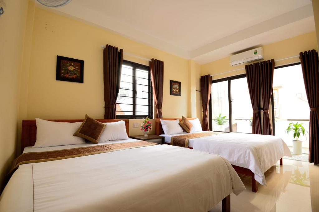 A bed or beds in a room at Guest House Maika