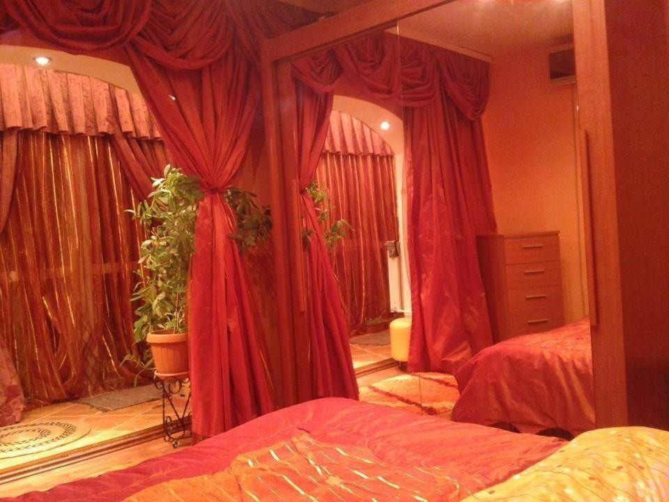 Un pat sau paturi într-o cameră la Sweet Homme