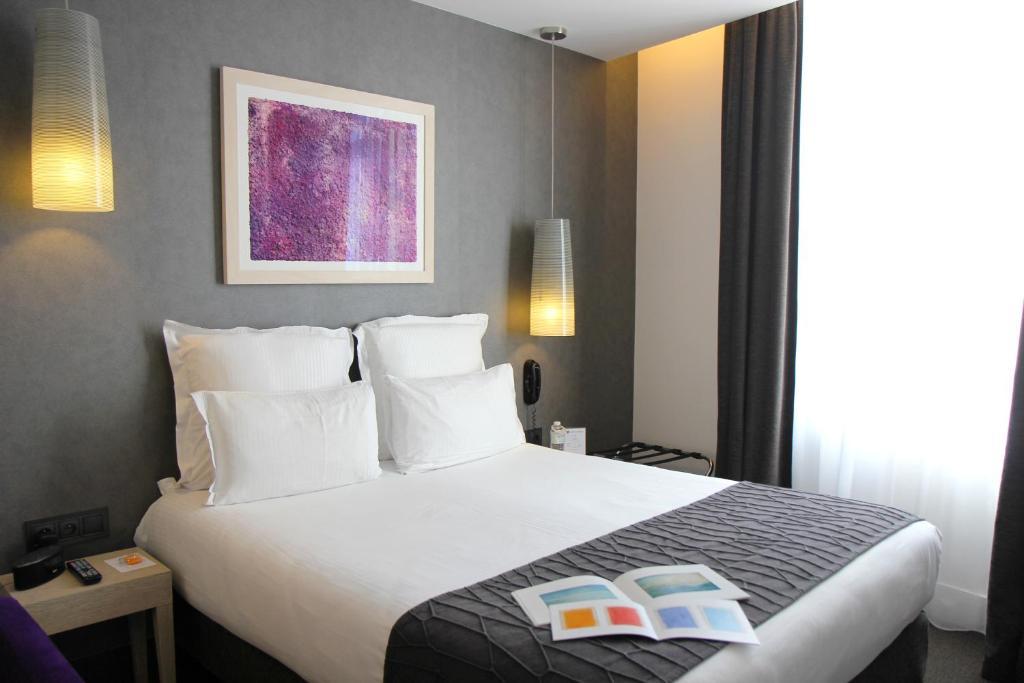 Un ou plusieurs lits dans un hébergement de l'établissement Best Western Plus Bordeaux Gare Saint-Jean