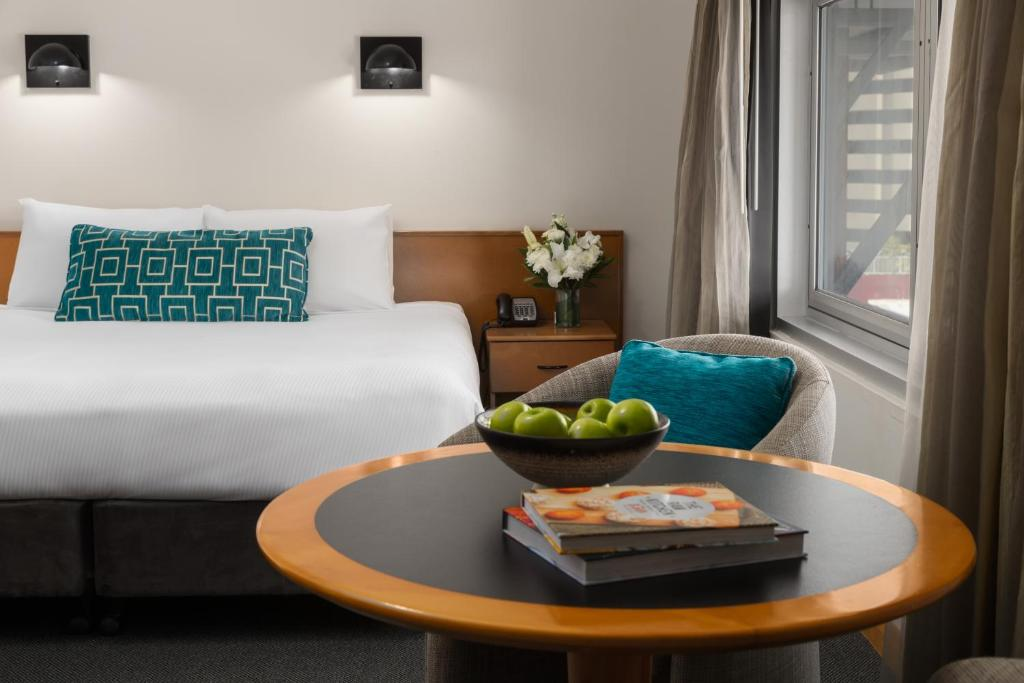 A bed or beds in a room at Rydges Darwin Central