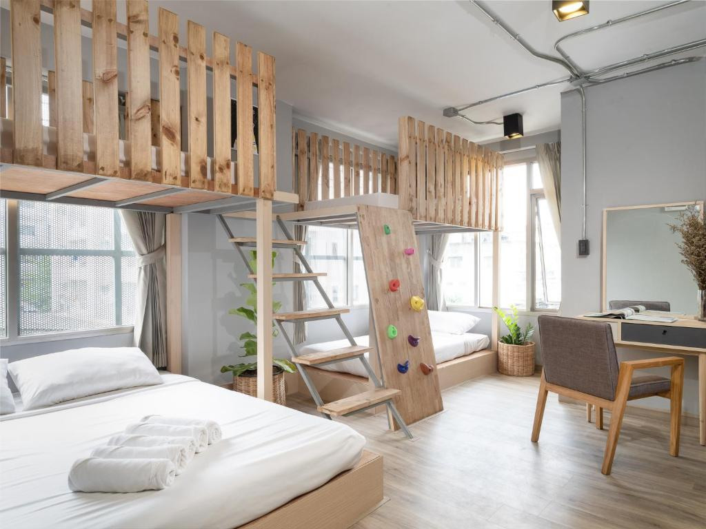A bunk bed or bunk beds in a room at Arch39 Minimal