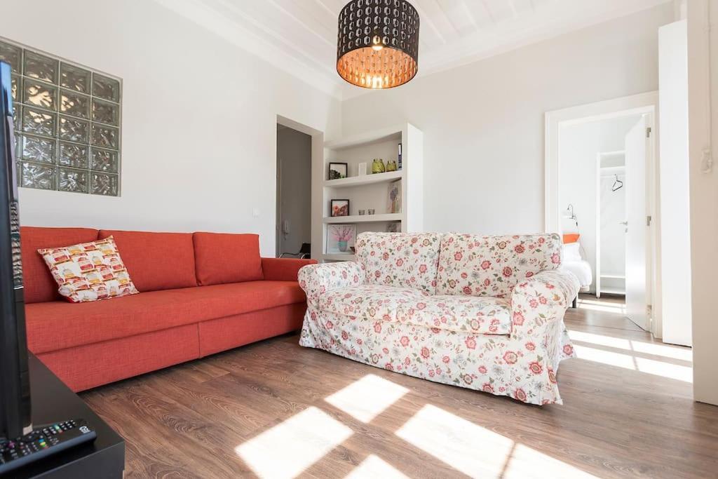 Een zitgedeelte bij Mouraria Cosy Apartment