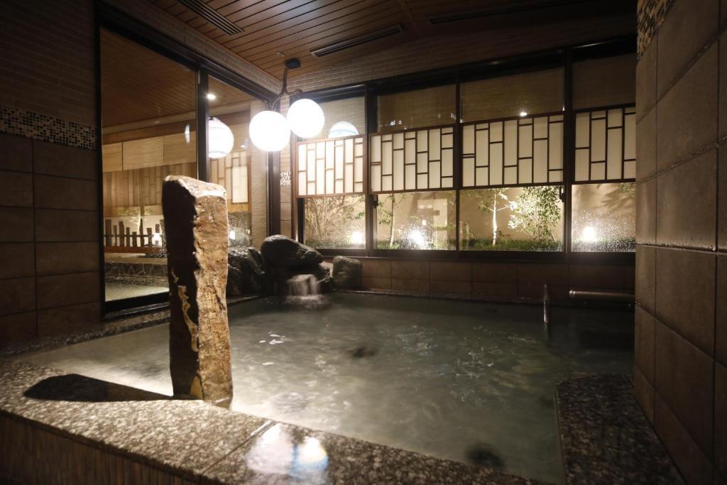The swimming pool at or near Dormy Inn Premium Osaka Kitahama
