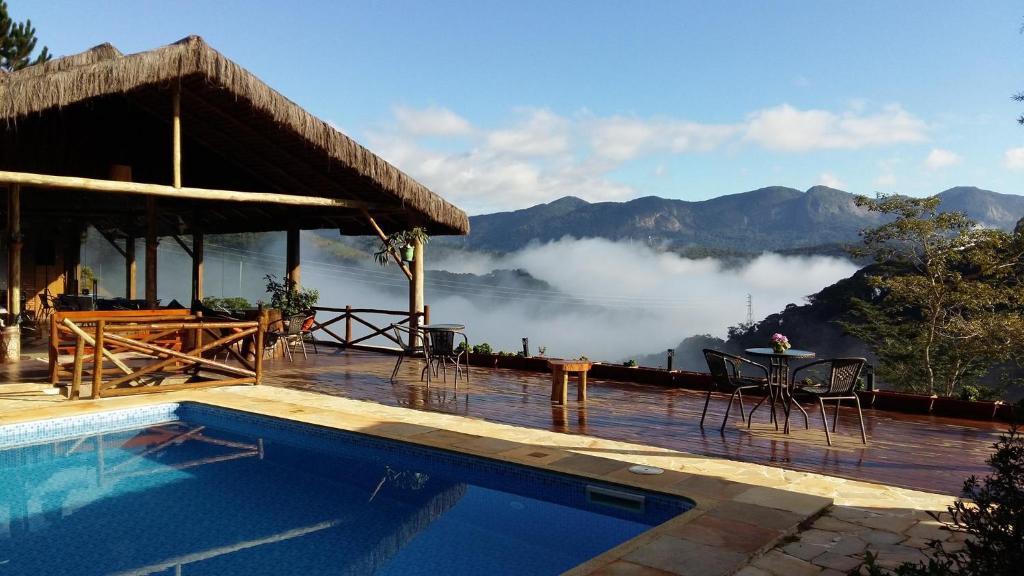 A piscina localizada em Pousada R.N.C. Nosso Paraíso ou nos arredores