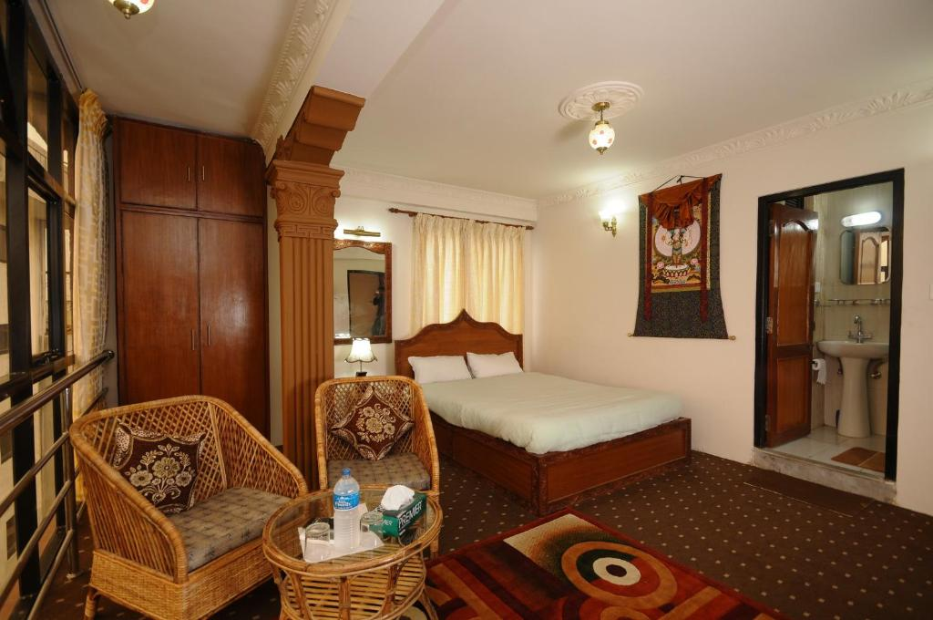 A bed or beds in a room at Hotel Manohara