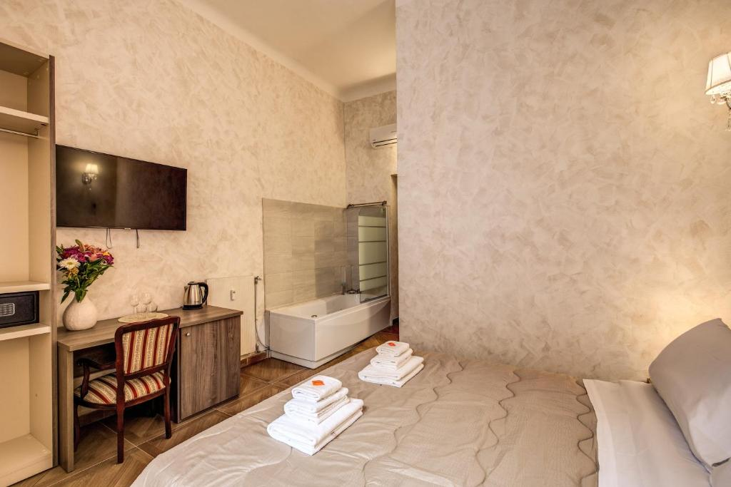 A bed or beds in a room at AMICI GUESTHOUSE