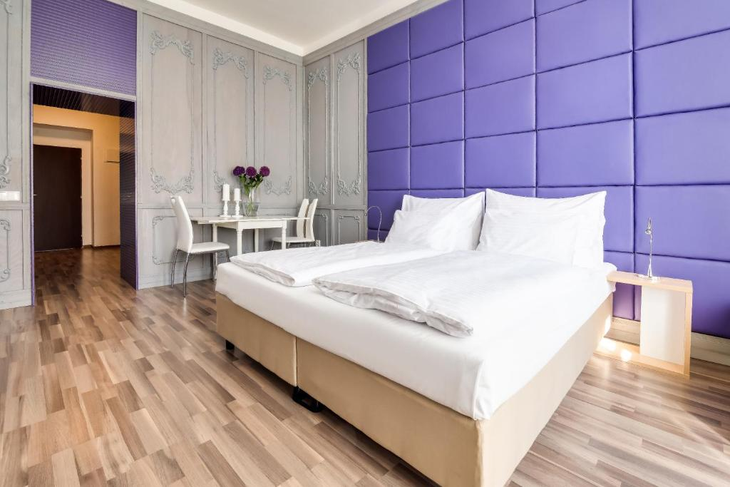 A bed or beds in a room at Bright Prague Castle Apartments