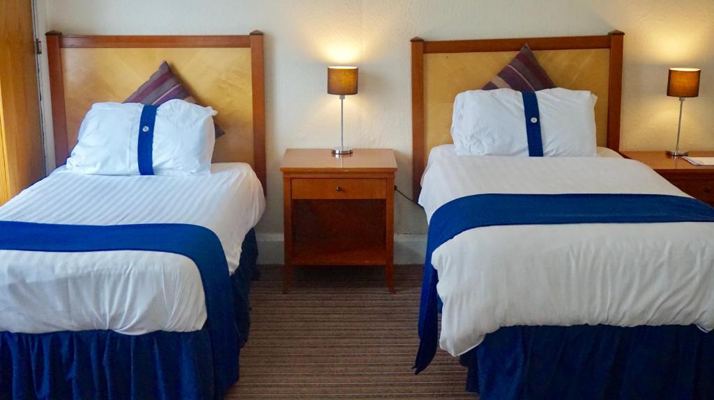 A bed or beds in a room at Stalbridge Guest House