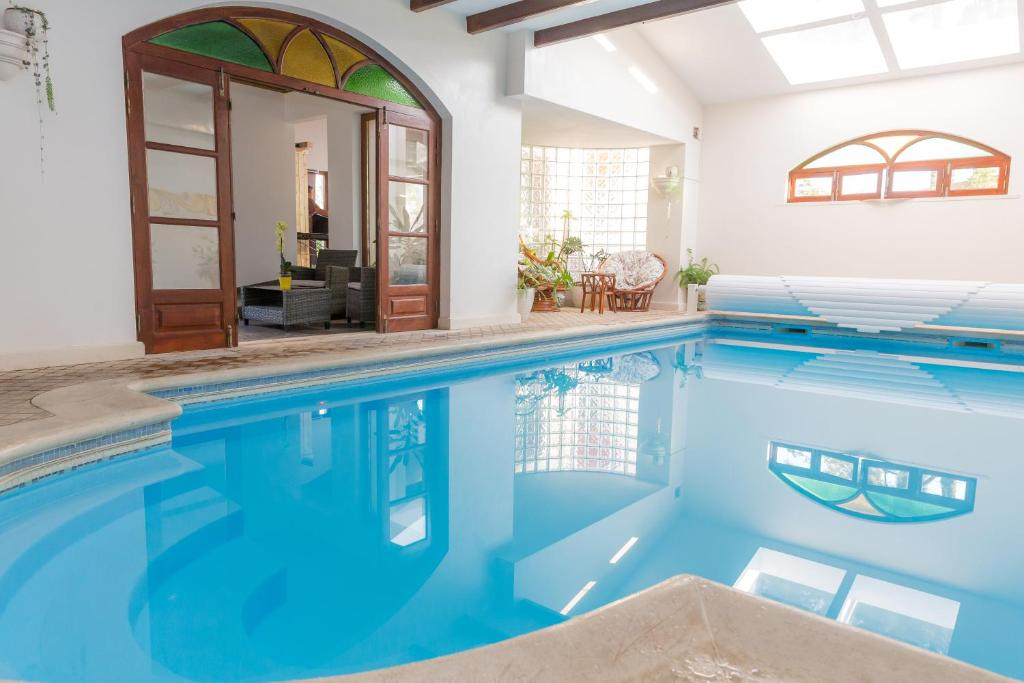 The swimming pool at or near Casal Dos 5