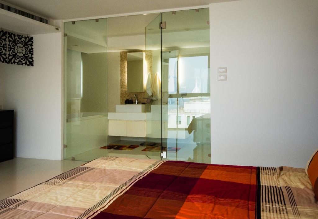 Кровать или кровати в номере Sanctuary Wangamat Condominimum 3 bedroom