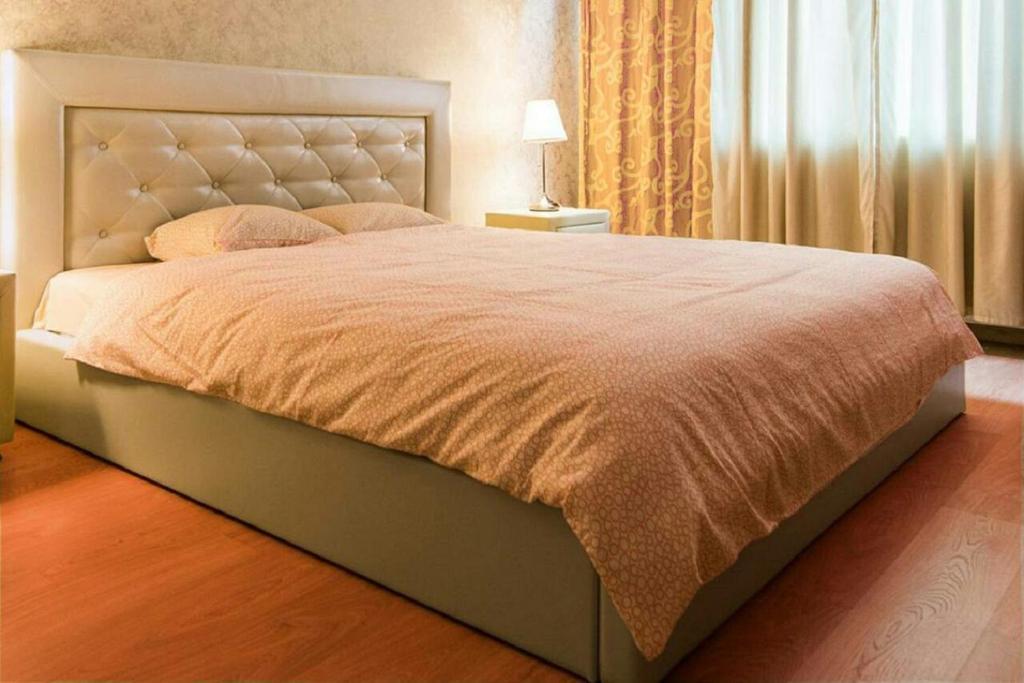 Кровать или кровати в номере Apartment Centre Nemiga 12