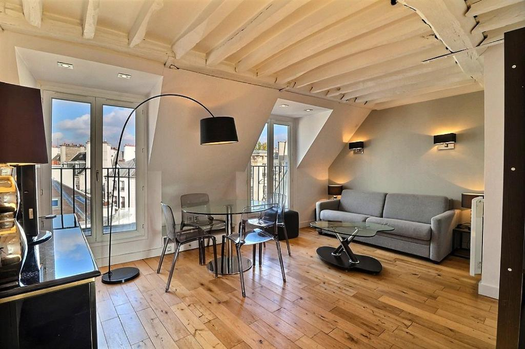 A seating area at PARIS 6TH - LATIN QUARTER - ST GERMAIN DES PRES