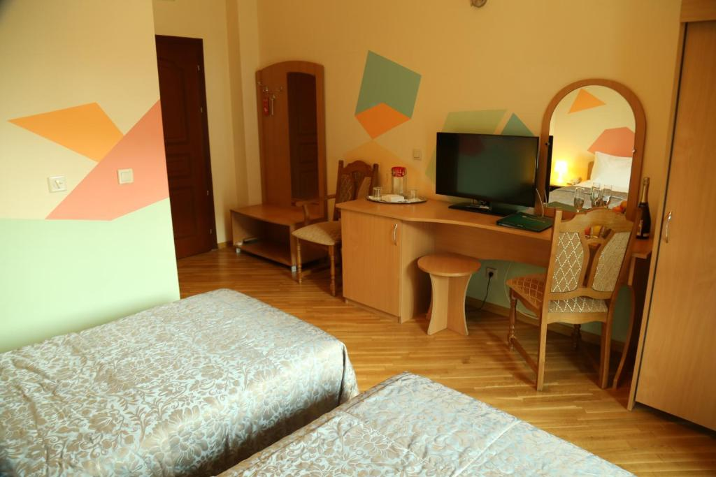 Кровать или кровати в номере Спа Отель Беларусь