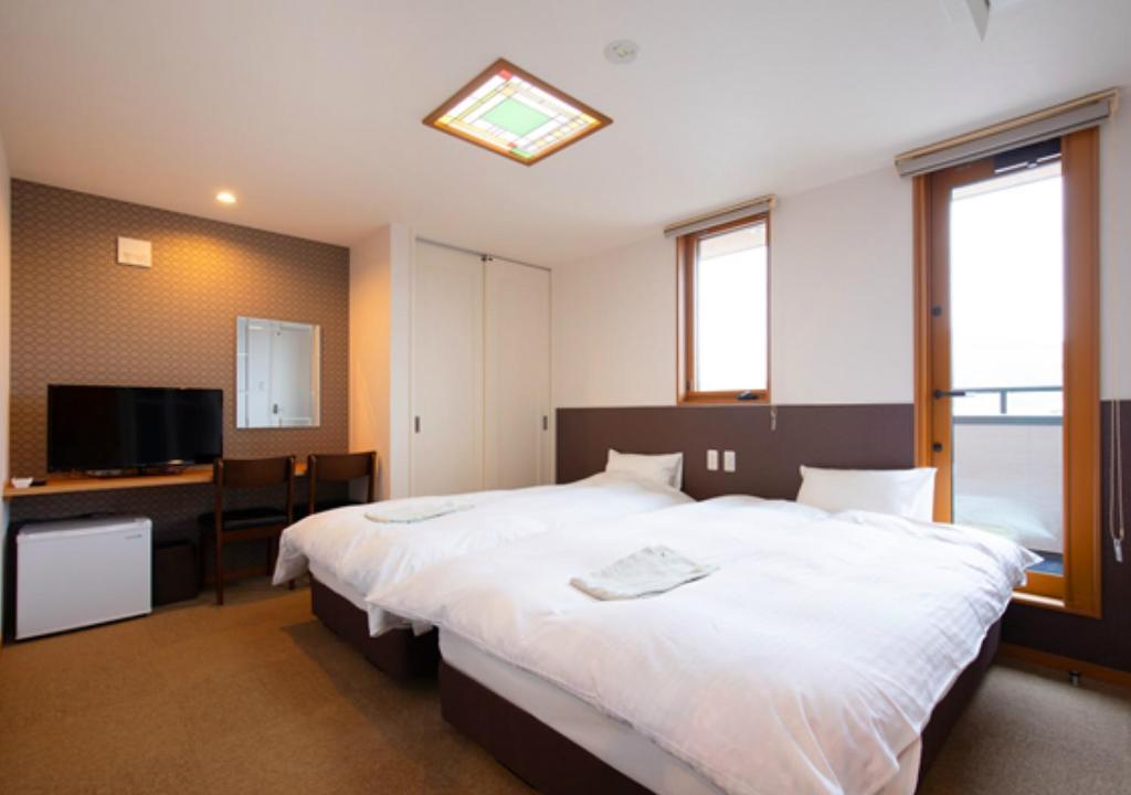 Un ou plusieurs lits dans un hébergement de l'établissement Wright Style