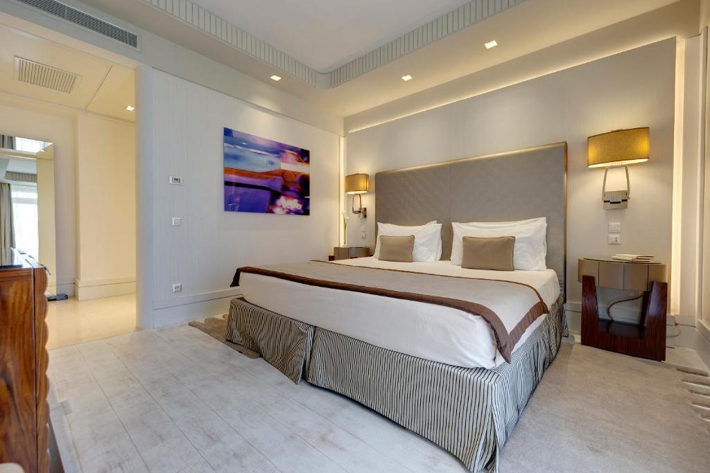 سرير أو أسرّة في غرفة في ميليا جينوفا