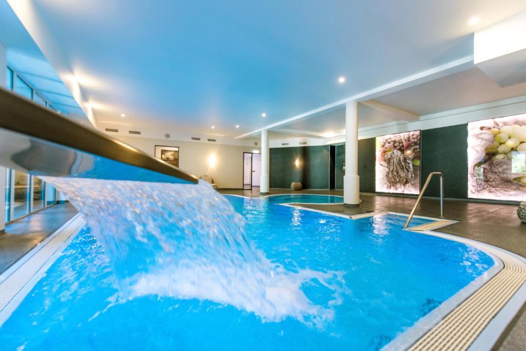 The swimming pool at or near Moselromantik Hotel Kessler Meyer