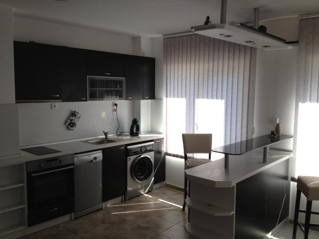 Кухня или кухненски бокс в Сити Апартамент