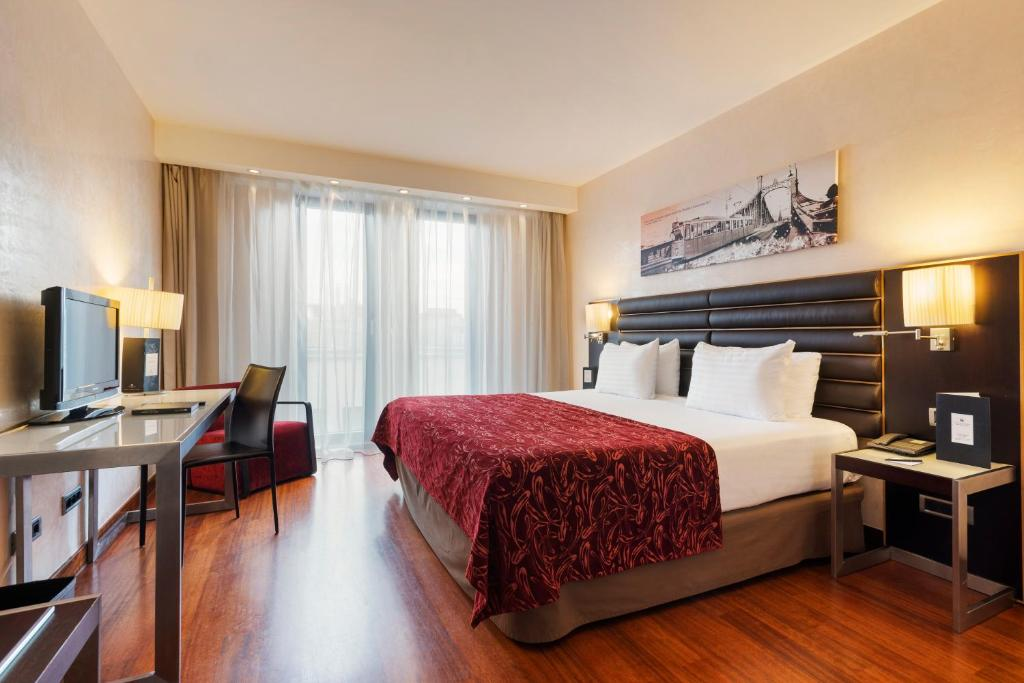 מיטה או מיטות בחדר ב-Eurostars Budapest Center