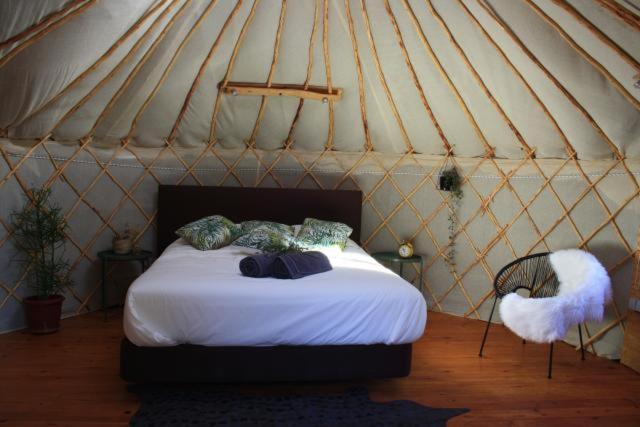 A bed or beds in a room at Yurt in orange grove