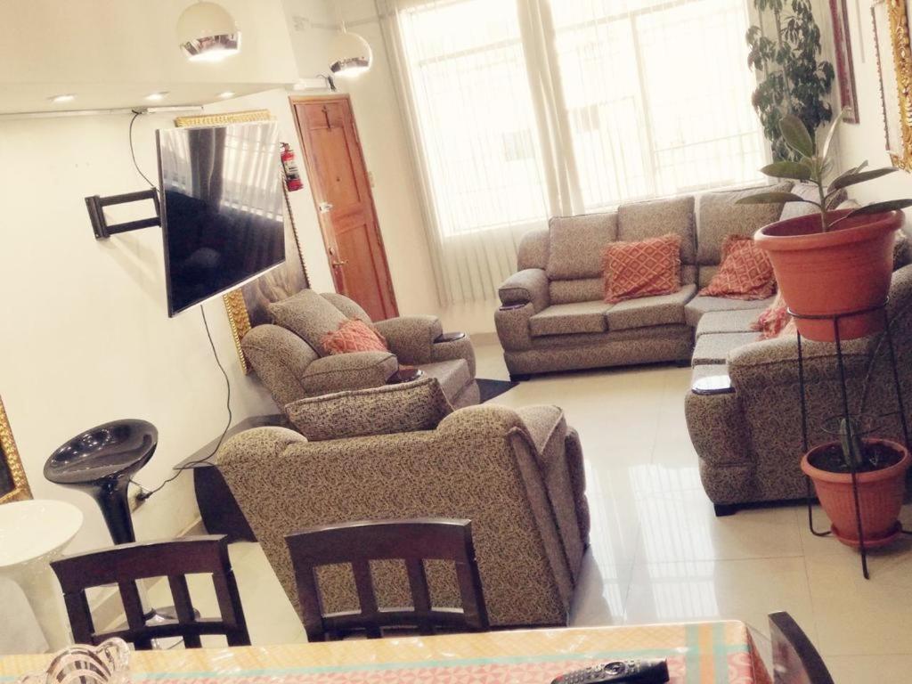 Zona de estar de Cusco Apartament