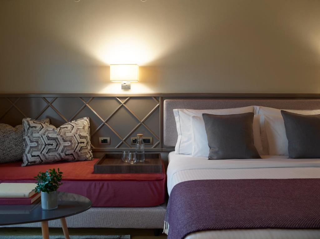 A bed or beds in a room at The Lake Hotel