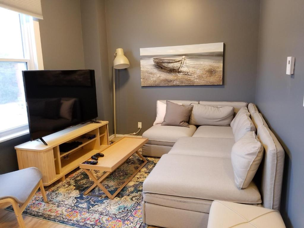 A seating area at JstLikeHome - Downtown Suites