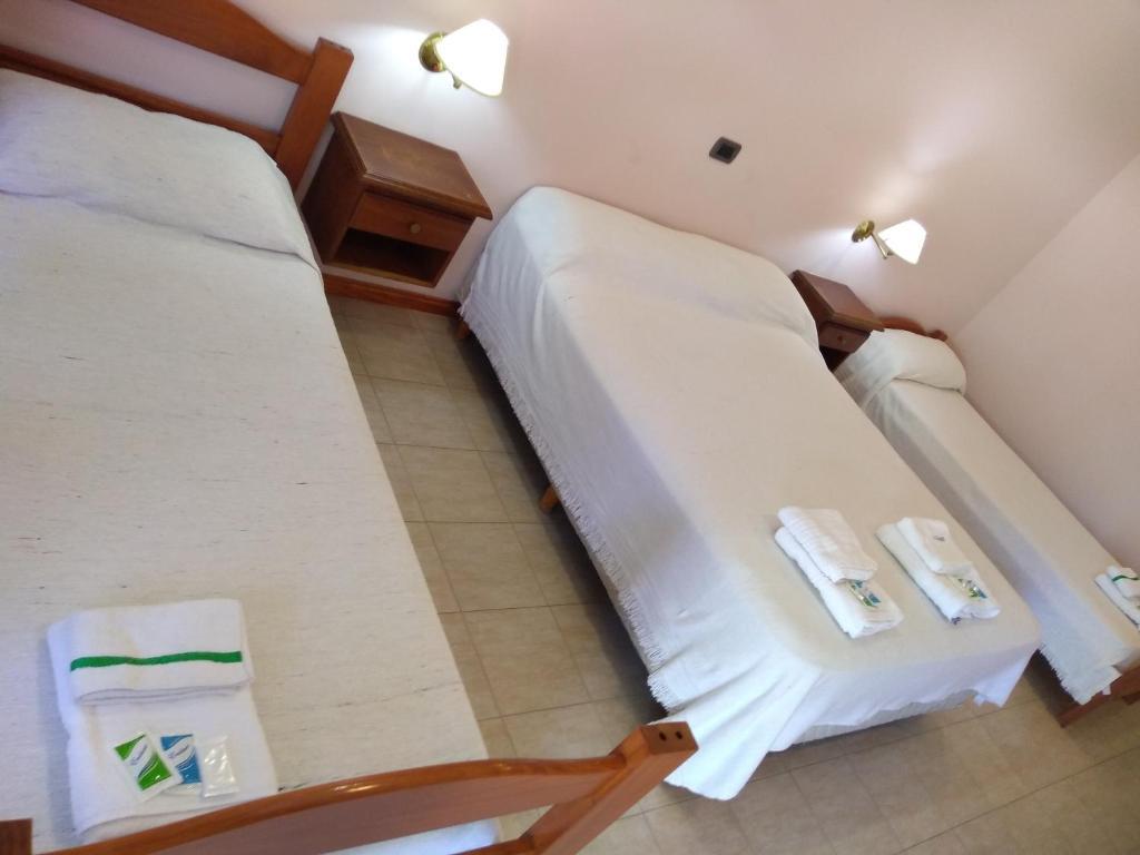 Una cama o camas en una habitación de Hotel Rucalen