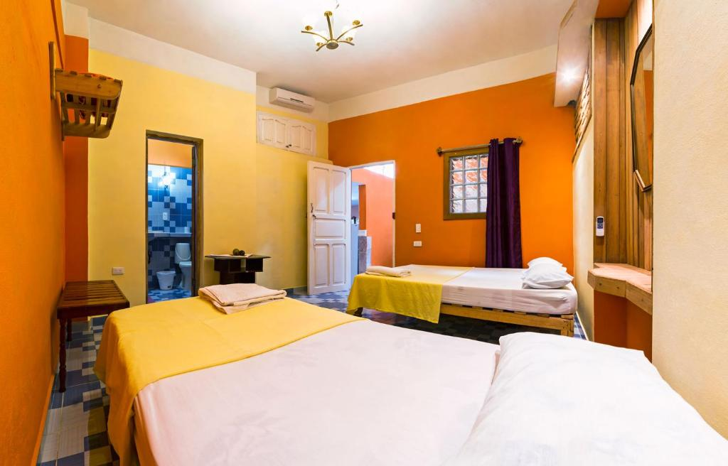 A bed or beds in a room at Casa Dona Antonia B2BPay