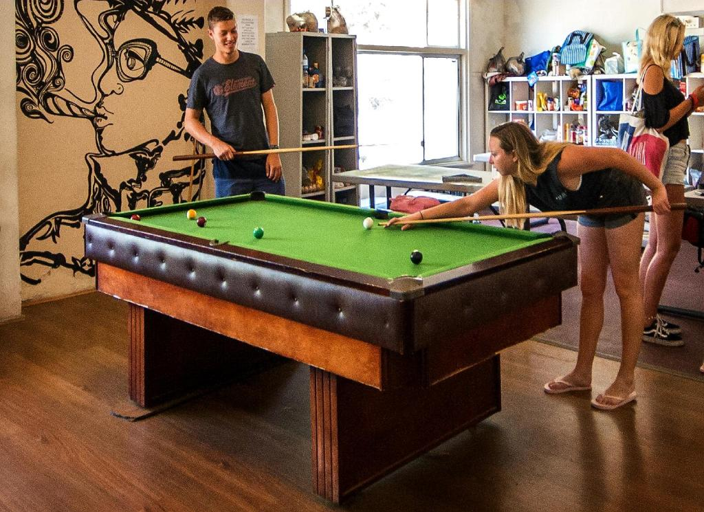 A pool table at The Hive Hostel