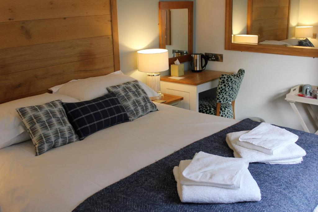 A bed or beds in a room at The Pityme Inn