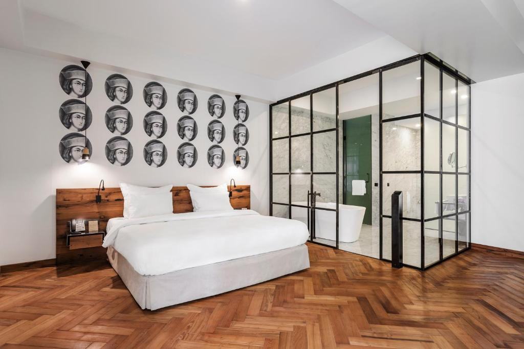 A bed or beds in a room at Shota @ Rustaveli Boutique Hotel