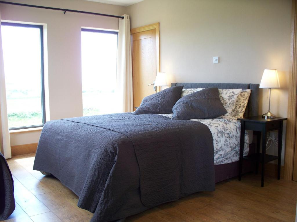 A bed or beds in a room at Blackberry Lodge Accommodation