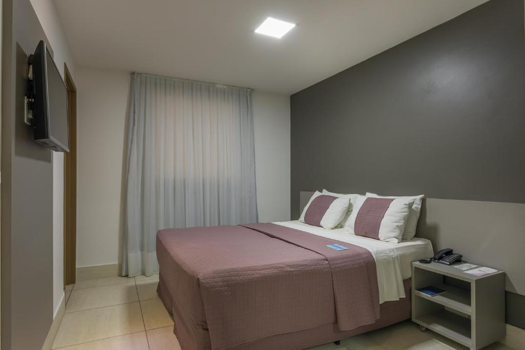A bed or beds in a room at Nord Easy Patos