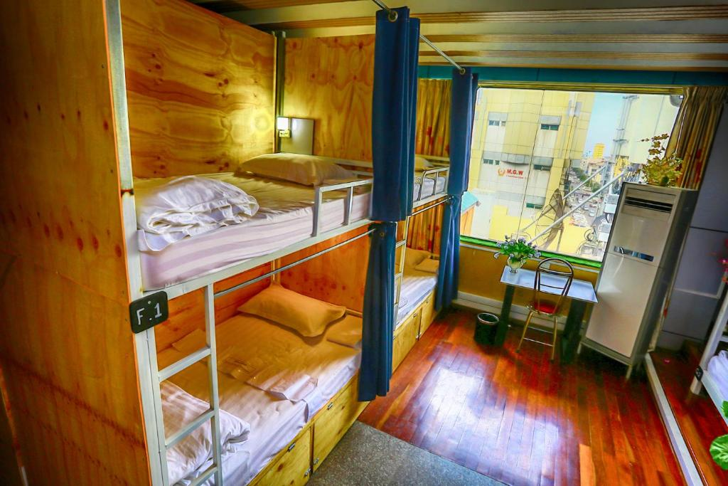 A bunk bed or bunk beds in a room at ABC Backpacker @ Golden City Light