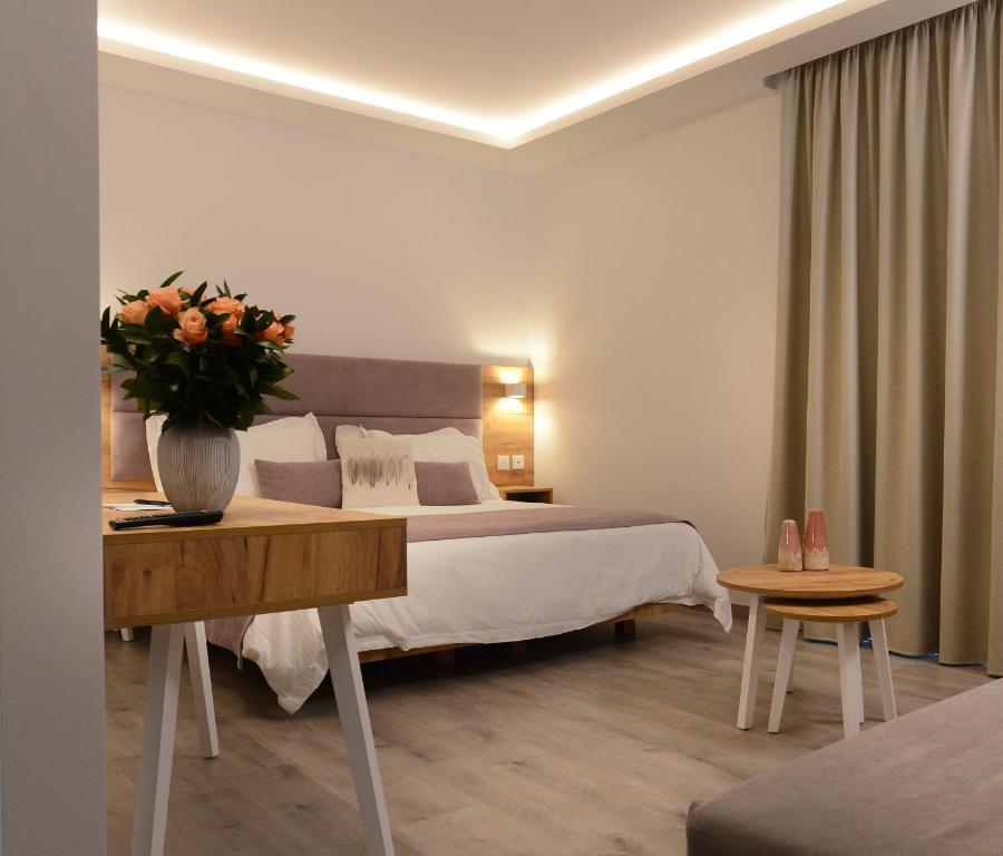 A bed or beds in a room at Hypnos by bed N' mix