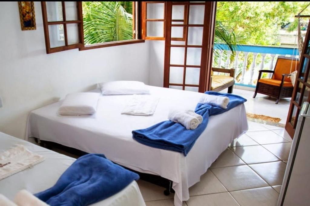 Łóżko lub łóżka w pokoju w obiekcie Pousada Barra da Tijuca