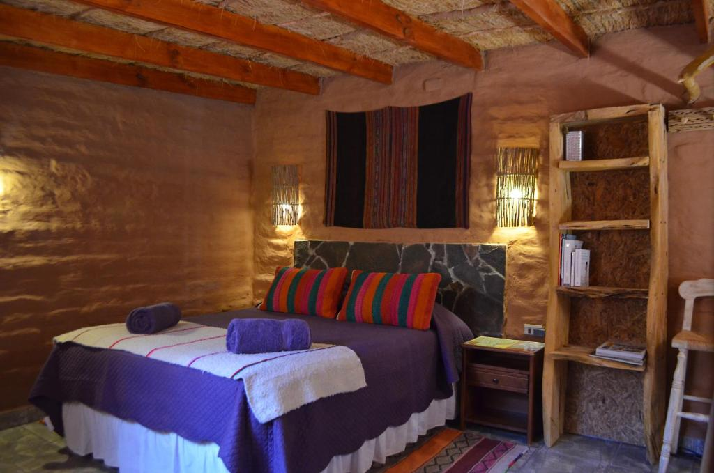A bed or beds in a room at Ckuri Atacama